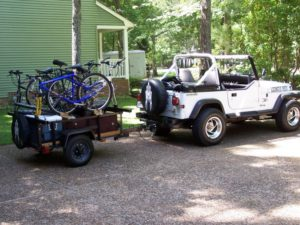 Jeep towing a heavy duty utility trailer