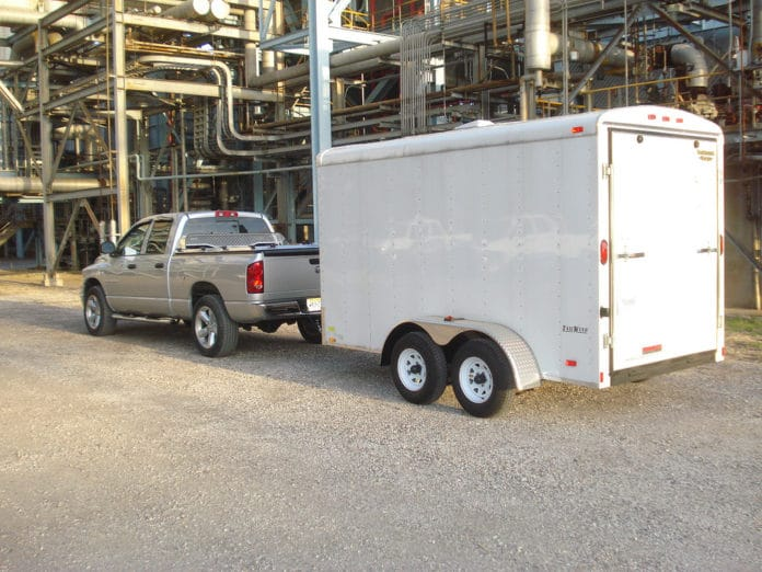 Dodge Ram pulling a Stealth Tall Enclosed Trailer Camper